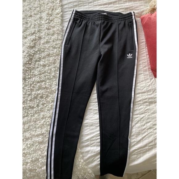 Adidas Superstar pants.